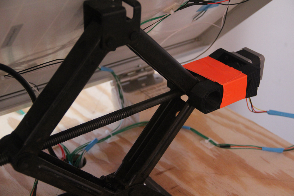 Car Jack Actuated by a Stepper Motor to move the panel up and down